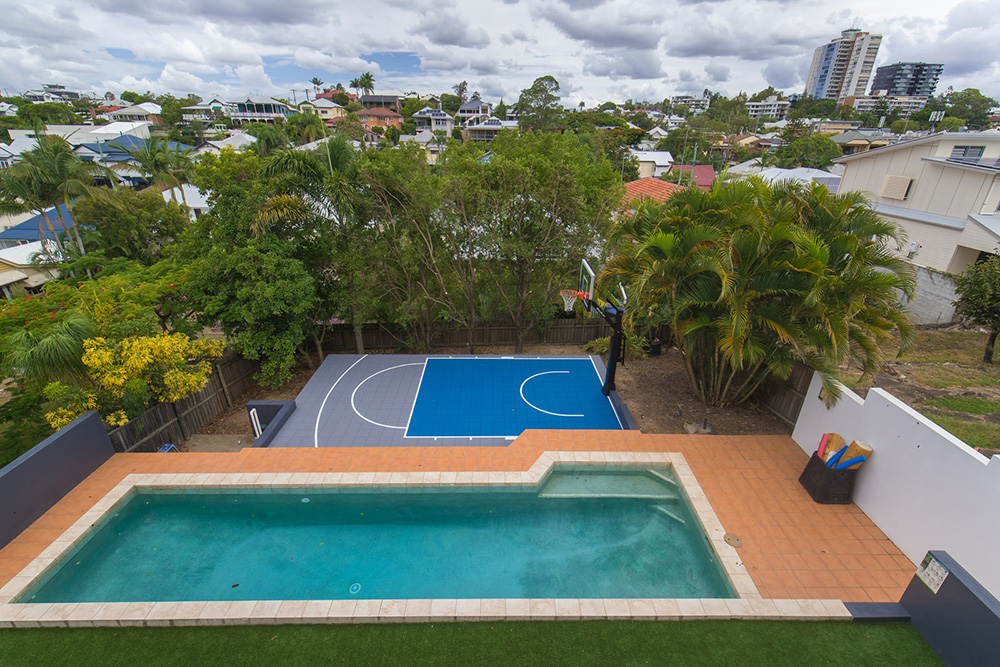 Aerial view of a backyard basketball court and swimming pool in Aussie backyard
