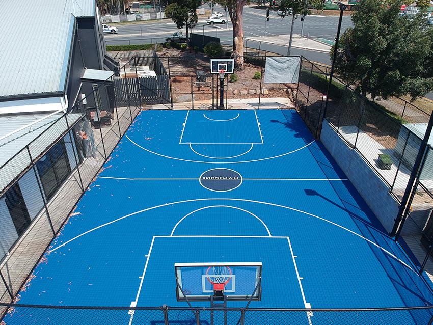 blue full basketball court at a church