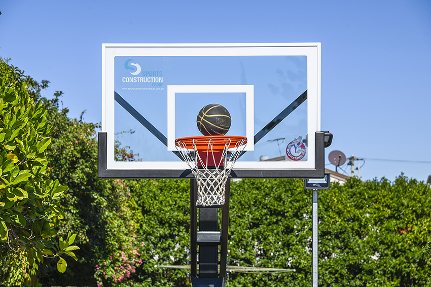 """Close up of Boomering basketball post with 60"""" backboard"""