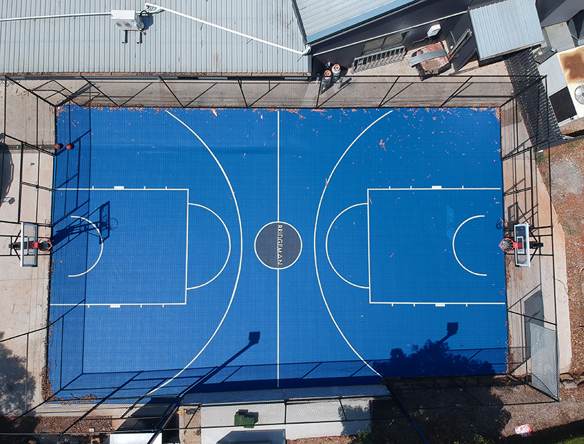 Aerial drone view of a full basketball court at a church in Brisbane