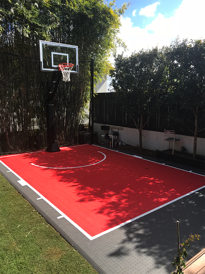 Red and grey backyard basketball court in Brisbane
