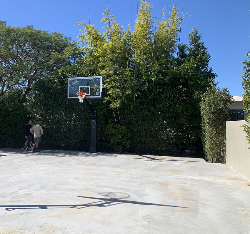 Concrete slab with basketball post