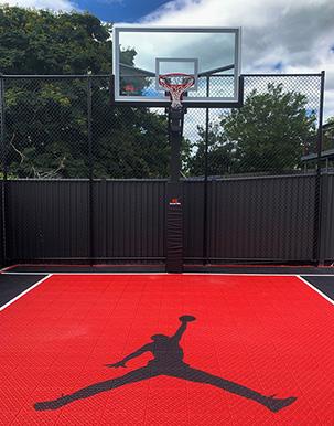 red and black basketball court in Brisbane backyard