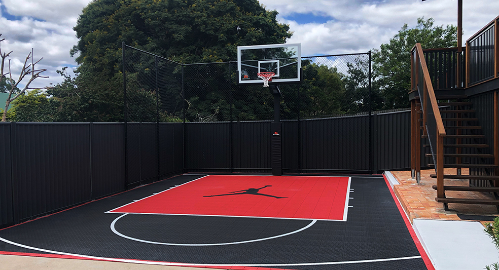 black and red basketball court in a backyard in Brisbane