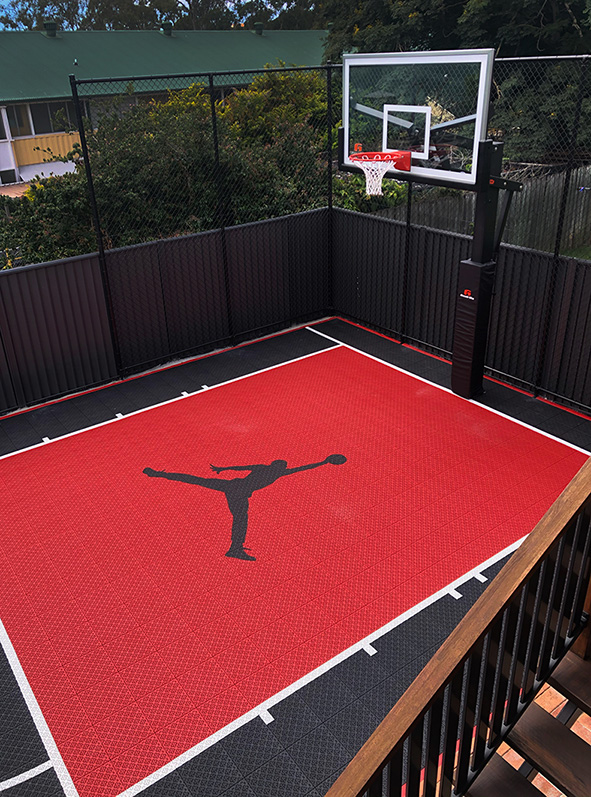 red and black basketball court with Jordan logo