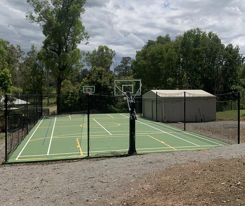 green basketball court in backyard