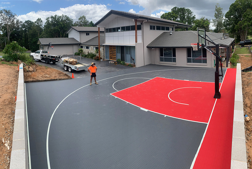 red and grey basketball court in Brisbane backyard