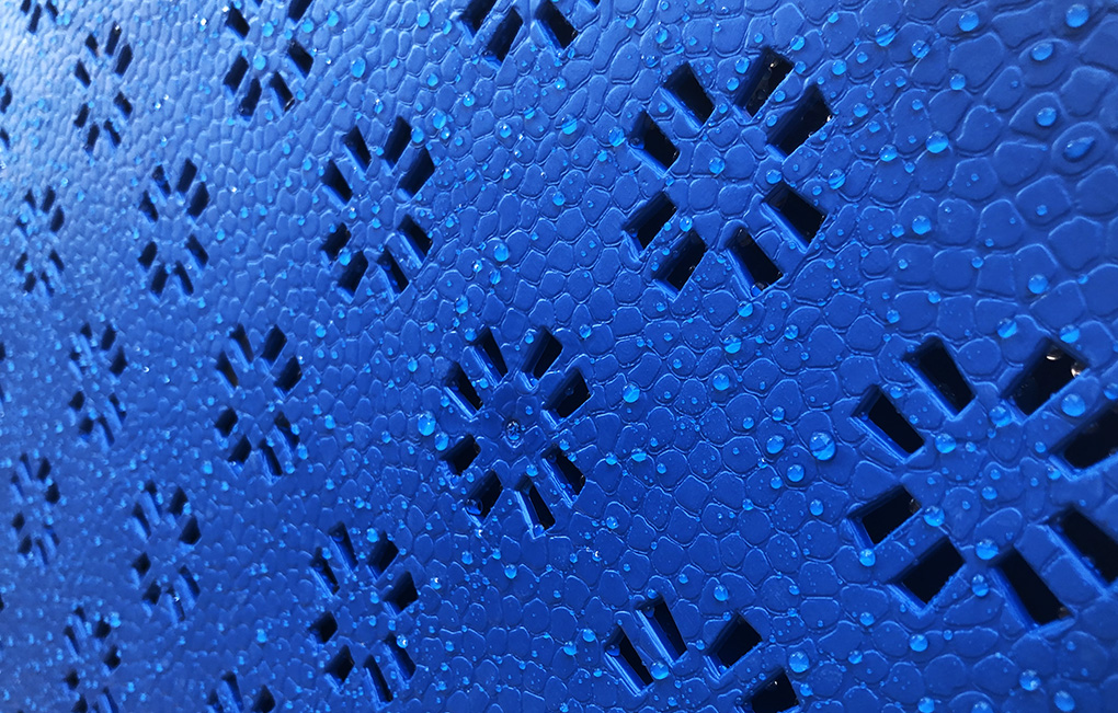 basketball sports court tiles made of rubber with water droplets on them