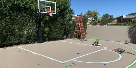 man line marking a basketball court