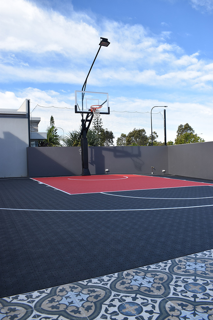 black and red basketball court in front yard